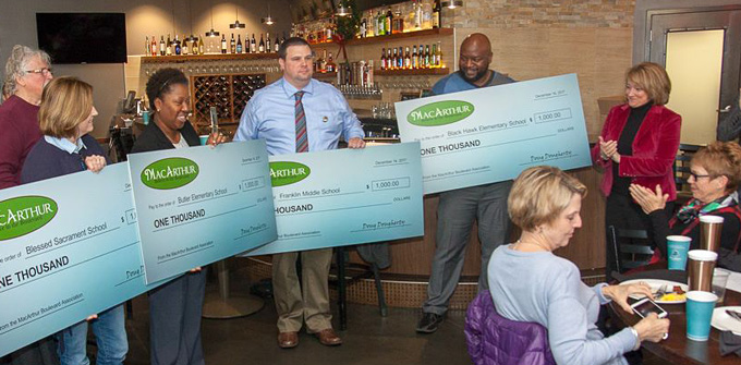 Black Hawk Elementary, Butler Elementary, Franklin Middle School, and Blessed Sacrament School each received $1,000 donations from Bites on the Boulevard proceeds.